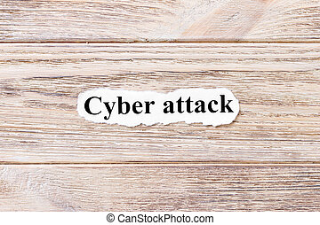 Cyber attack of the word on paper. concept. Words of Cyber attack on a wooden background