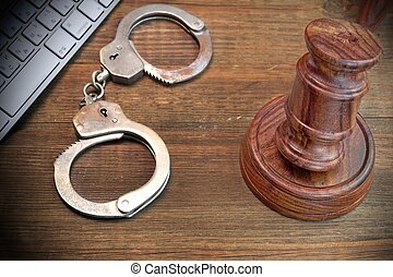 Cyber Crime Concept, Gavel Keyboard And Handcuffs On The Table