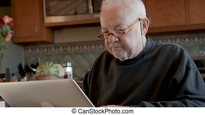 Cyber criminal stealing money from an unsuspecting elderly man on a computer