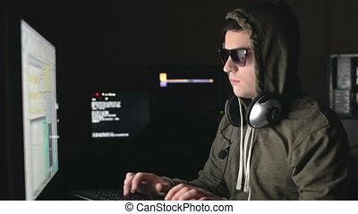 Cyber Mafia - Young man in hood and spectacles with earflaps...