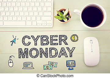 Cyber Monday message with workstation on a light green...