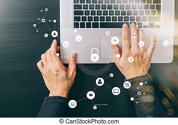 cyber security internet and networking concept. Businessman hand working with VR screen padlock icon on laptop computer
