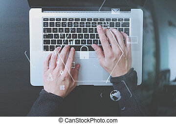 cyber security internet and networking concept.Businessman hand working with VR screen padlock icon on laptop computer background