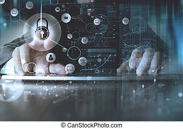 cyber security internet and networking concept.Businessman hand working with VR screen padlock icon on computer background