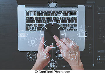 cyber security internet and networking concept.Businessman hand working with VR screen padlock icon mobile phone on computer background