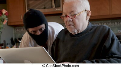 Cyber thief hacking into a man's computer while he is logged...