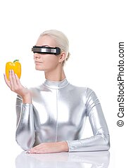 Cyber woman with sweet pepper
