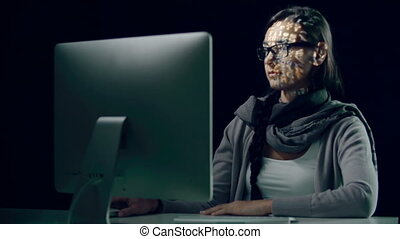 Cyberspace Crime - Woman computing in the dark with binary...