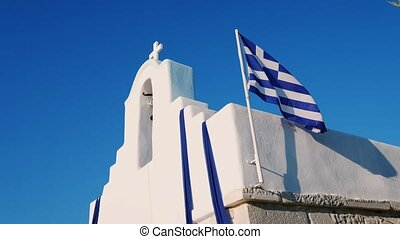 Cycladic church with greek flag - Cycladic church with...