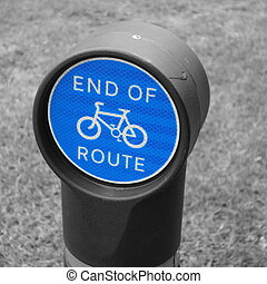 Blue circular sign marking end of cycle route