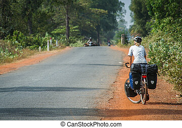 Cycle touring in Cambodia - Woman on a cycle touring trip in...