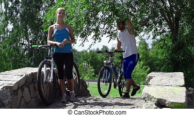 Cycleway Romance - Slow motion of man joining lady on the...