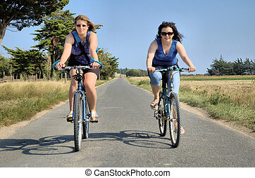 Cycling at leisure - two young women on a summer cycle ride