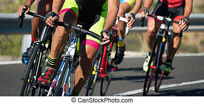Cycling competition, cyclist athletes riding a race at high ...