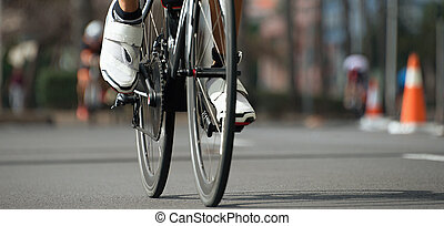 Cycling competition, cyclist athletes riding a race