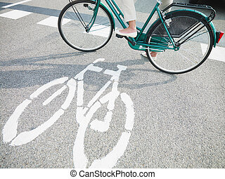 cycling lane sign - cropped view of woman commuting on ...