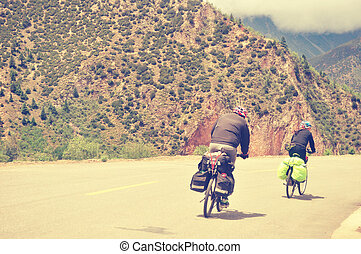 cycling on mountain road - mountain bike rides along the ...