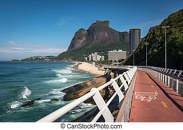 Cycling path along the beautiful coast of the Rio de Janeiro city, Brazil.