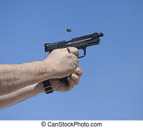 Cycling semi auto pistol - Empty brass leaving a semi auto...