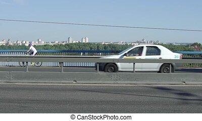 Cyclist And Cars On Bridge
