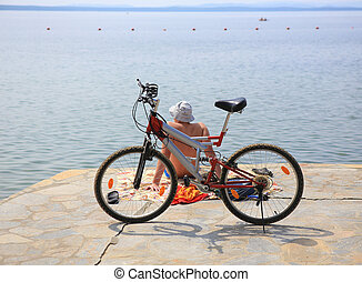 cyclist and the bicycle on the coast