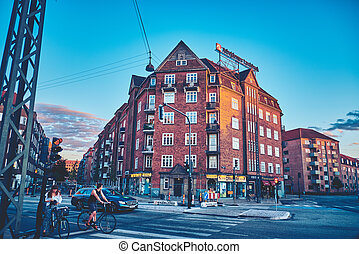 Cyclist at the crossroads waiting for the green light. Denmark, Copenhagen.