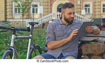 Cyclist browse interntet on the tablet