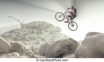 Cyclist climbing on a rock. - Cyclist making tricks on a...