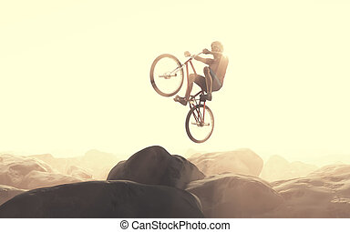 Cyclist climbing on a rock. - Cyclist jumping on a rock....
