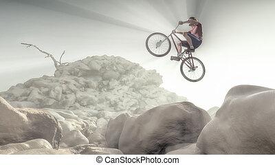 Cyclist climbing on a rock. - Cyclist making tricks on a...