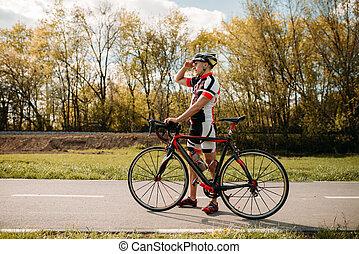 Cyclist, cyclocross training on bike path