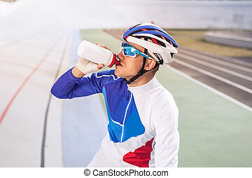 Cyclist drinking water
