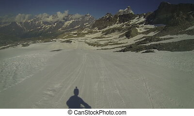Cyclist going downhill on snow