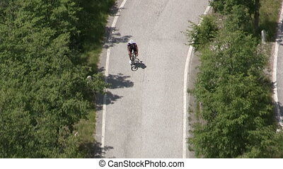 Cyclist going up on small road