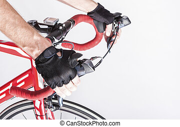Cyclist Hands in Protective Gloves Put on Handlebars....