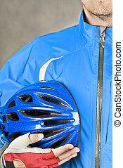 Cyclist Holds Helmet 2