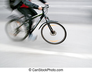 cyclist in blurred motion with neutral background