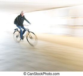 cyclist in blurred motion - Male cyclist in blurred motion...