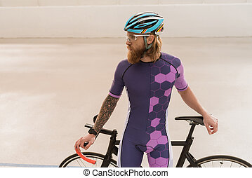 cyclist in helmet with bicycle