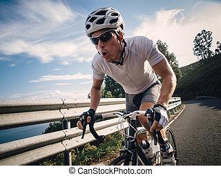 Cyclist in maximum effort in a road