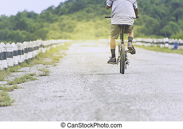 cyclist in motion on the background of beautiful sunset, ride bicycle.