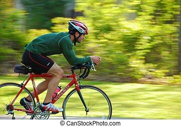 A cyclists on the Onondaga Lake Park exercise path near Syracuse, New York.