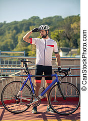 Cyclist in sportswear and helmet admiring the view