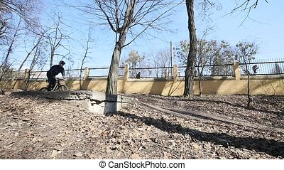 cyclist jumping in the park. slow motion
