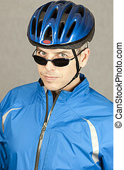 Cyclist Looks To Camera