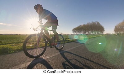 cyclist riding bike working out training fitness outdoor tracking shot from camera car slowmotion