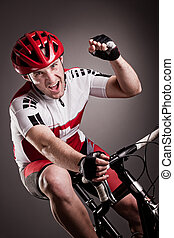 cyclist on a bicycle - fully equipped cyclist riding a...