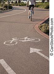 Cyclist on bike lane in an urban setting