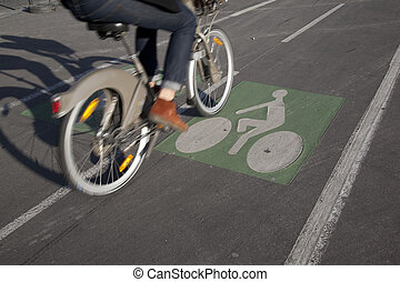 Cyclist on Bike Lane in Paris