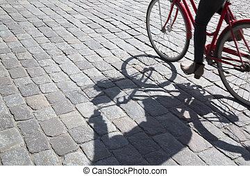 Cyclist on Cobblestones, Stockholm